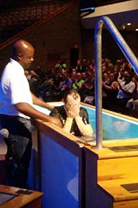 Anthony being baptized